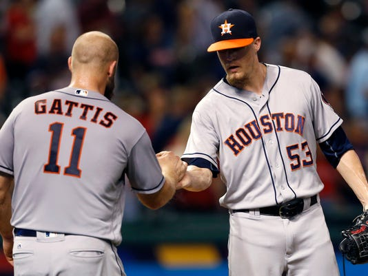 Houston Astros relief pitcher Ken Giles (53) and catcher Evan Gattis celebrate the team's 4-3 win over the Cleveland Indians in a baseball game Tuesday, Sept. 6, 2016, in Cleveland. (AP Photo/Ron Schwane)