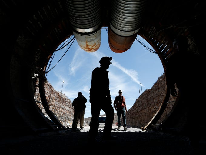 People walk into the south portal of Yucca Mountain