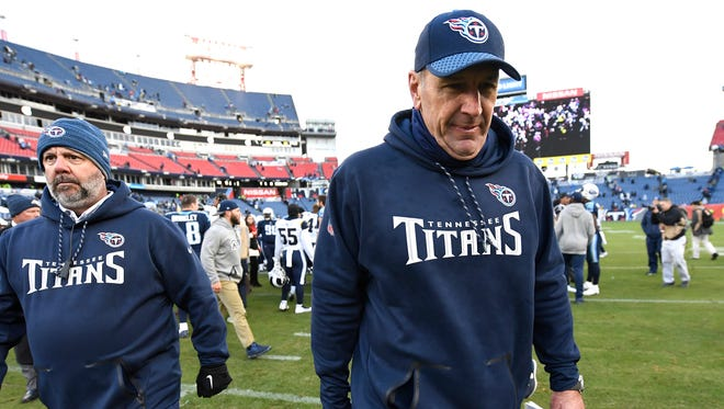 Titans head coach Mike Mularkey walks off the field after the team's loss to the Rams at Nissan Stadium Sunday, Dec. 24, 2017 in Nashville, Tenn.