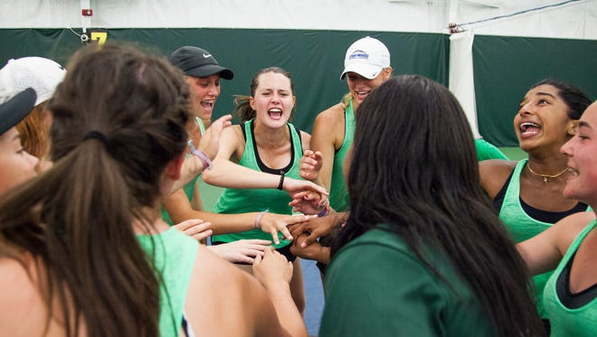 Iowa City West players celebrate after winning the team title during the Iowa Girls' High School 2A Tennis Tournament at Hawkeye Tennis and Recreation Complex in Iowa City on Saturday, June 2, 2018. (Joseph Cress/For the Press-Citizen)