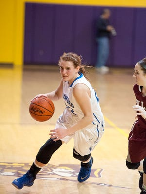 Wynford guard Gretchen Harris drives around the Willard defense.
