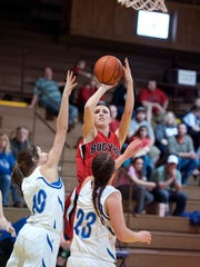 Bucyrus' Gabby Seibert attempts a short jump shot over the Riverdale defense.