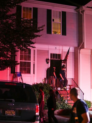 Emergency responders work at a home on Denny Circle in Bear after one person was found dead and a woman had to be rescued from the home following a ceiling collapse Wednesday.