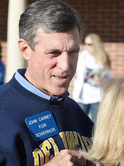 Congressman John Carney, Democratic candidate for Delaware's governor, makes a stop at the Cape Henlopen High School polling place near Lewes on Tuesday morning, greeting voters.