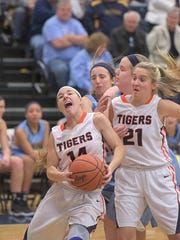 Galion's Gabby Kaple drives to the basket as Sophie