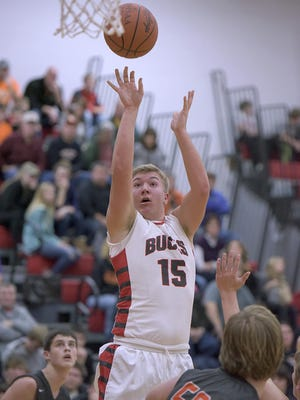 Buckeye Central's Jacob Shade attempts a jump shot. Shade went on to finish with 12 points.