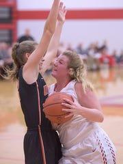 Erin Baldosser drives to the basket against Upper Sandusky.