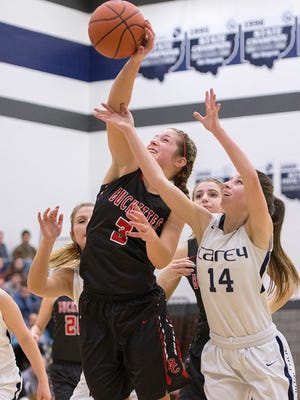 Buckeye Central's Jenna Karl fights for control of the ball.