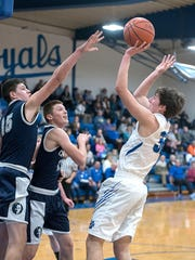 Wynford's Thad Hensel attempts a shot over the Carey