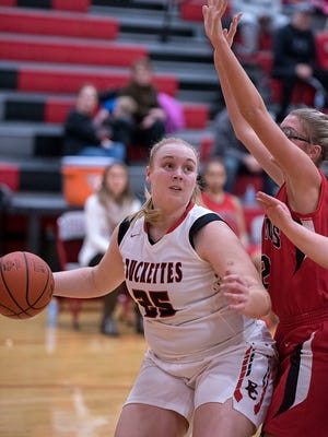 Buckeye Central's Courtney Pifher looks to the basket with Bucyrus' Ashtyn Simms guarding her.