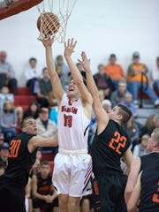 Bucyrus' Clinton Carr goes up for the score.