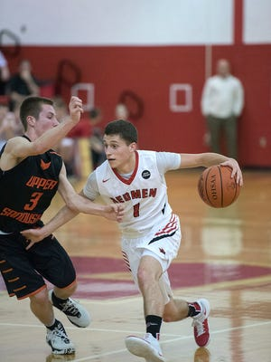 Bucyrus' Gram Dick drives the ball towards the basket against the Rams.