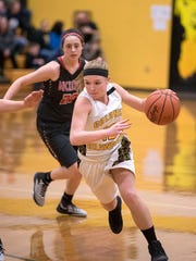 Colonel Crawford guard Taylor Webster drives toward
