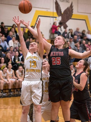 Colonel Crawford's Claire Ehmann and Buckeye Central's Courtney Pifher compete for a rebound.