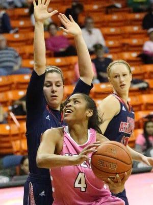 UTEP guard Lulu McKinney drives to the basket against Nika Zyryanova of Florida Atlantic Thursday night in the Don Haskins Center.