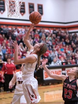 Buckeye Central's Isabelle Biglin scores a basket against St. Paul in the district final.
