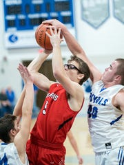 Bucyrus' Derek Heinlen shot is knocked away by Wynford's