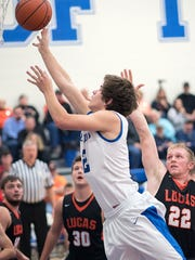 Crestline's Ty Clark goes up for a shot.