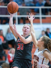 Buckeye Central's Kyleigh Brown goes for a easy layup.