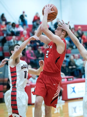 Bucyrus' Harley Robinson takes a shot over Buckeye Central's Wade Ackerman.