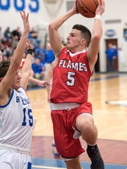 Mansfield Christian's Jared McPeek launches toward the basket.