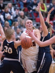 Buckeye Central's Courtney Pifher slices through the Carey defense for a basket.