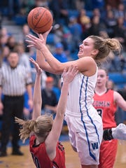 Wynford's Olivia Grove drives toward the basket.
