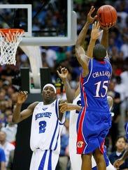 Memphis players look on as Kansas' Mario Chalmers,