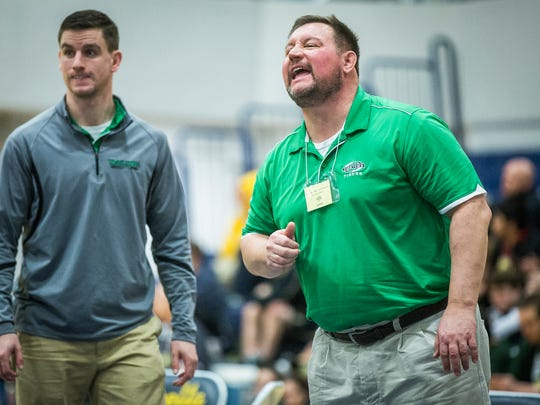 FILE -- Former Yorktown wrestling coach Trent McCormick knew he wanted to return to athletics after he left Yorktown, but he wanted to work in administration. He has that opportunity now in Covington.