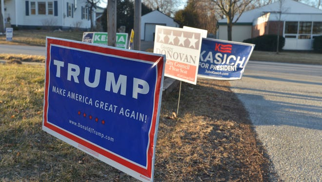 A sign for Republican presidential candidate Donald Trump is one of the few signs of the primary at the entrance of the Orchard School, a South Burlington, Vt., polling station, on Tuesday, March 1, 2016.
