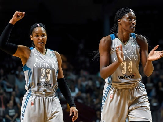 Minnesota Lynx forward Maya Moore (23) and Minnesota Lynx center Sylvia Fowles (34) celebrate after forcing a Washington Mystics timeout during the second half of a WNBA basketball game, Tuesday, Sept. 12, 2017 in Minneapolis. (Aaron Lavinsky/Star Tribune via AP)