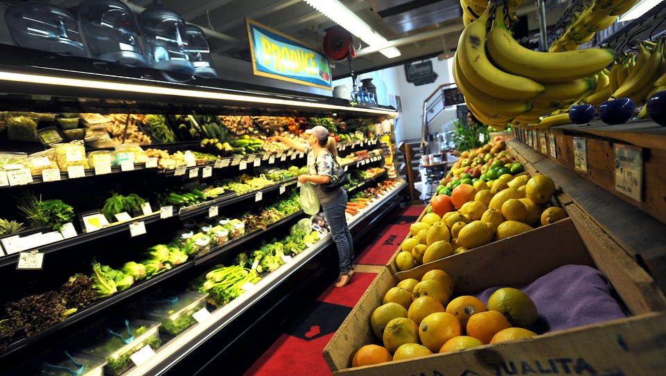 A woman is seen shopping for produce at the Great Basin