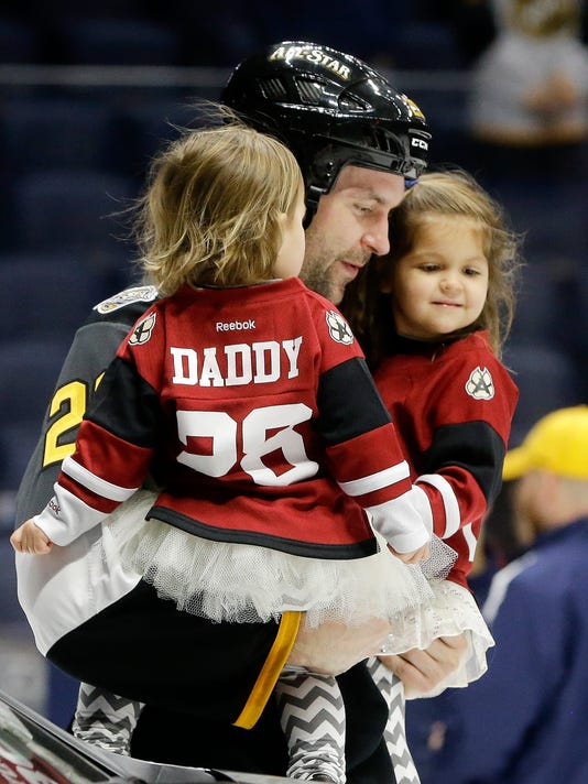 0f5a40ea355ff Pacific Division forward John Scott carries his children onto the ice after  being named the most