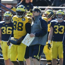 Michigan quarterback Devin Gardner gets a play from offensive c