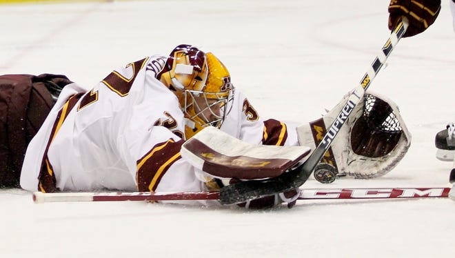 Minnesota goalie Adam Wilcox (32) stops a shot on goal against Ohio State during the second period of a Big Ten Conference semifinal Friday, March 20, 2015, in Detroit.