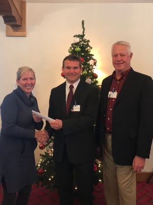 Mary Carlisle, left, DCMC auxiliary president, and Jeff Heck, auxiliary president-elect, give a check to Brian Stephens, Door County Medical Center administrative officer.