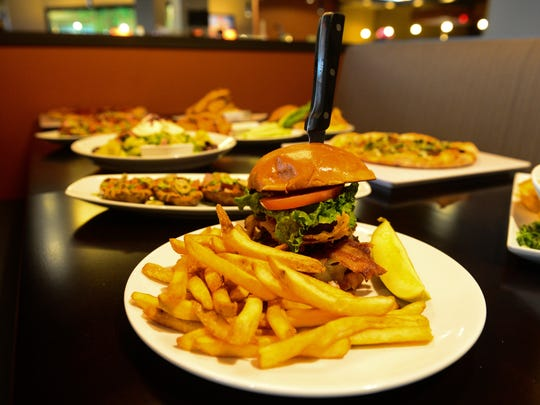Meals at Lefty's Alley and Eats range hamburgers and wings to entrees such as braised short ribs and grilled pork loin.