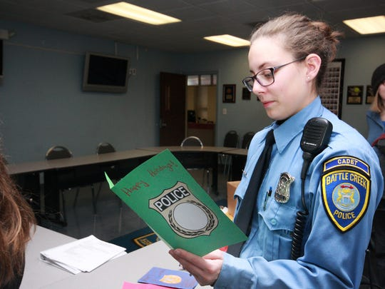 Cadet Savannah Anderson reads one of the card that was handmade by Springfield Middle School students Monday morning.