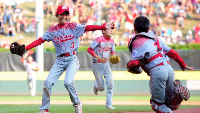Japan Region pitcher Nobuyuki Kawashima celebrates after beating the Mid-Atlantic Region 18-11 to win the Little League World Series at Howard J. Lamade Stadium.