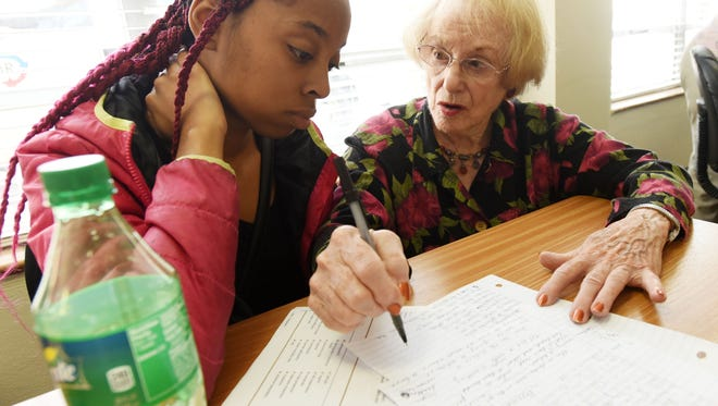 Diana Ely, right,  helps Kenyotta Toliver study for her GED at the Community Renewal International's Adult Academy.