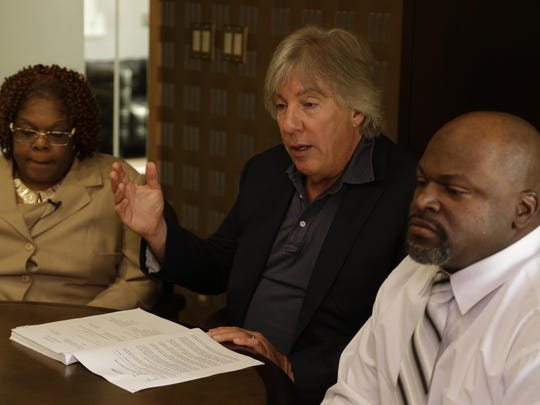 Lawyer Geoffrey Fieger with Tamara Nichols and her brother Michael Nichols. They are suing the state over the death of their mother last summer.
