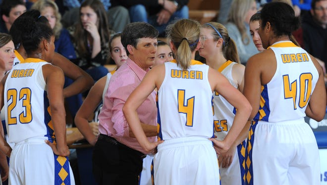Wren head coach Lynn Hicks talks with her team as they play Easley Tuesday at Wren High in Piedmont. The Hurricanes defeated the Green Wave giving Hicks her 500th win.