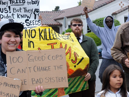 Around 30 determined people attended a #Baltimore2California peace rally at Hartnell College on Monday, then marched to the Salinas Police Department carrying signs and chanting.