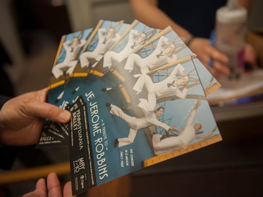 David Gray, new executive director of the Pennsylvania Ballet, looks over promotional material for the upcoming production of 'A Tribute to Jerome Robbins,' which runs through Sunday.