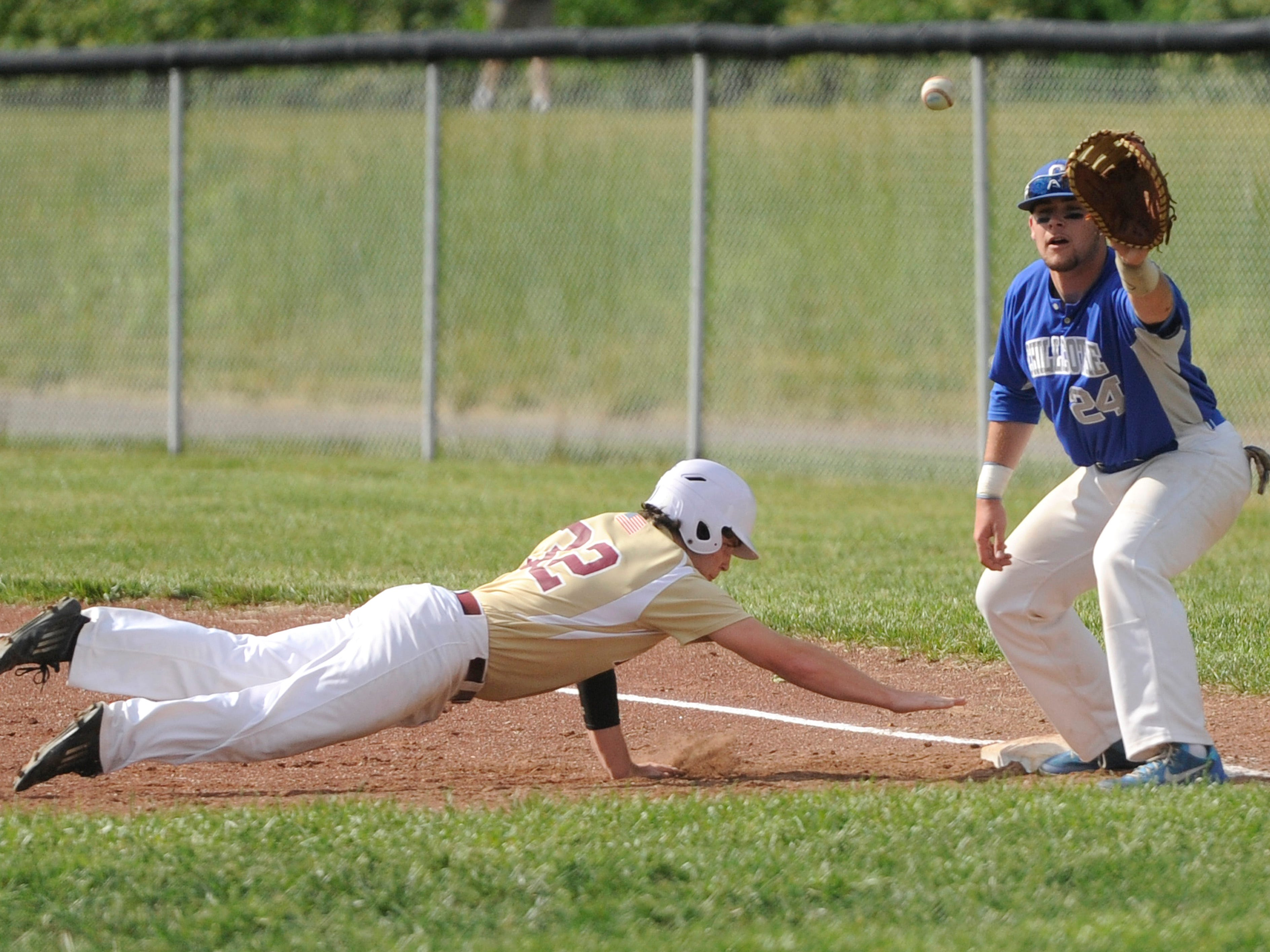 Chillicothe's Gage Jones holds a runner at first during the Cavaliers' 5-0 loss to Licking Heights in the Division I Sectional Semi-Final at Chillicothe on Tuesday.