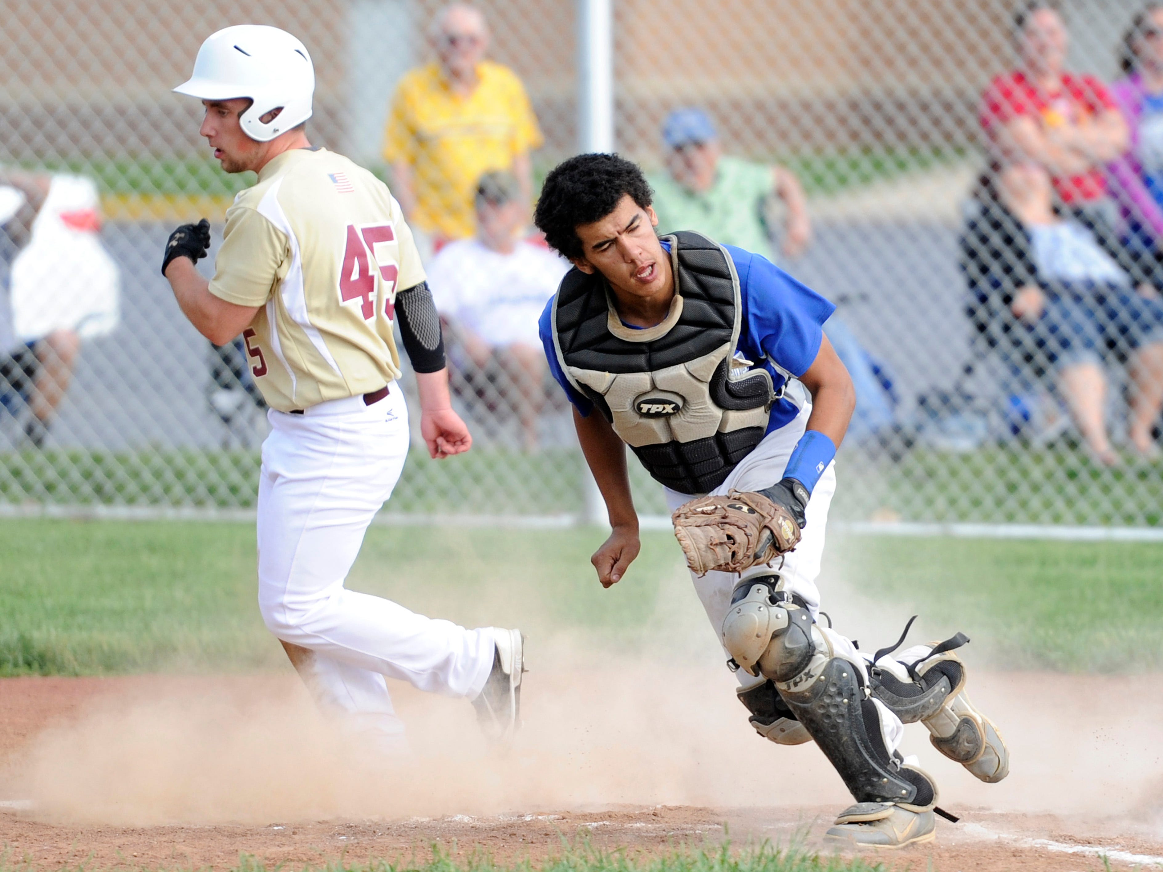 Chillicothe's catcher Noah Jackson reacts to missing the ball thrown to him at home plate allowing Licking Heights to score a run during the Division I Sectional Semi-Final at Chillicothe on Tuesday. The final score was Chillicothe 0, Licking Heights 5.