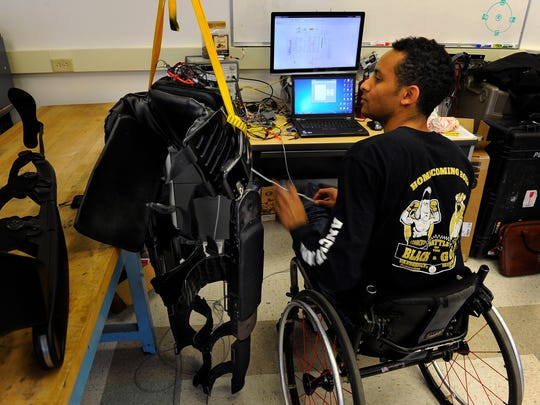 Andrew Ekelem works on an exoskeleton that could one
