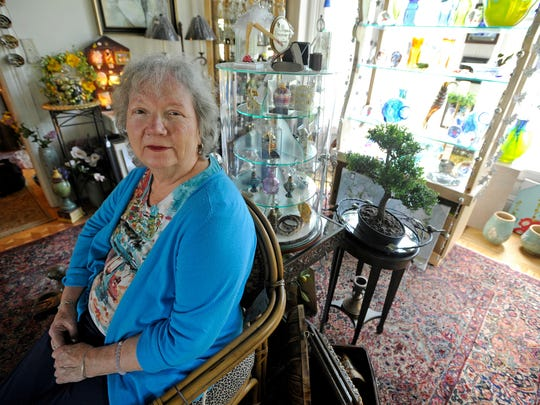 Rowena Perry sits inside her business, House of Design,