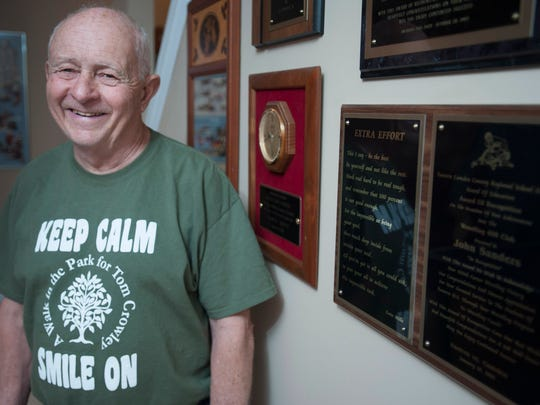 Former wrestlers want to name the school gym after former Eastern wrestling coach John Sanders.