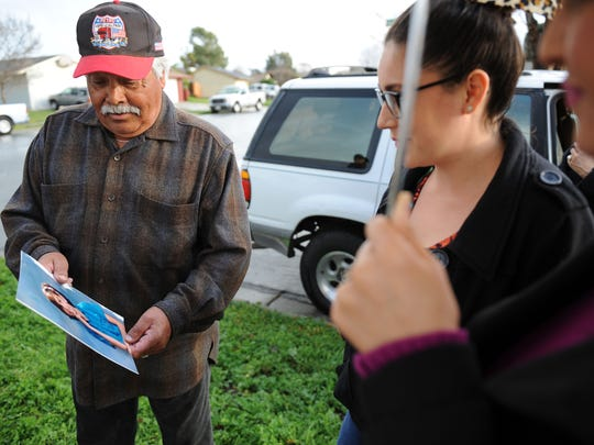 """John Piña shows a photograph of Christy at Sunday's """"100 Mothers"""" vigil in north Salinas for victims of Monterey County violence."""